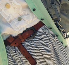white button up blouse, blue and white striped skirt, and mint green sweater