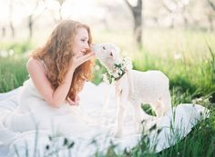 Springtime farm photoshoot / little lamb / white dress / green grass / inspiration