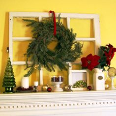 i have a leaded glass window that would be perfect to layer on my mantel w. a wreath.  great idea.