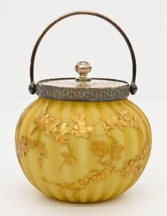 Thomas Webb Yellow Satin Glass Jar Gilt decorated with blossoming flowers. on Jul 2017