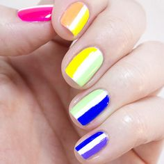 Instead of the standard horizontal stripes, create this rainbow nail design with vertical ones. Check out the full tutorial to get this mani yourself.