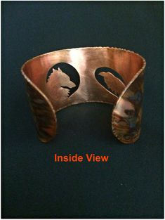 My Process: Inspired by customer request, this unique cuff bracelet is hand cut from copper sheet using a tiny serrated handheld jewelers saw. To produce the image, I use a pierce and cut technique, feeding the saw blade through a tiny hole pierced in the sheet metal and then cutting out the design using a series of inside and outside cuts. I use a hammering technique to shape the cuff and tooling techniques to create the markings. A black patina is then added to the copper to enhance the…