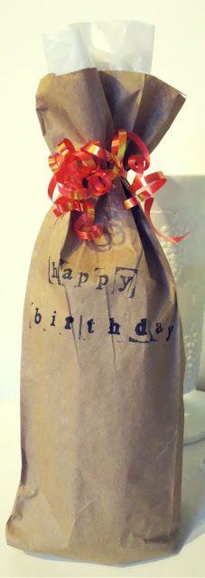 Forget about buying a gift bag! Use the brown paper bag that is given when you purchase the bottle!