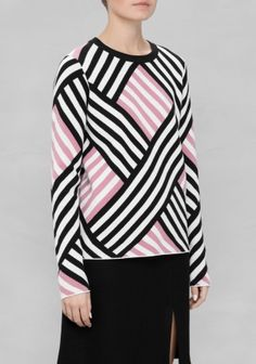 The contrasting colour blocking of diagonal stripes defines this bold sweater fashioned into a versatile, straight silhouette.