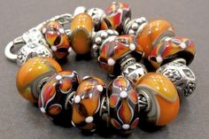 Brown & Orange Uniques Quite unusual beads By Sharon Menkhaus