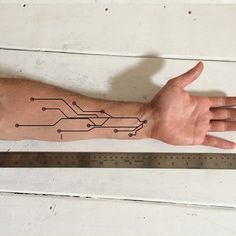 Design a functional tattoo for Ben Uyeda that turns his arm into a ruler Design by wanbe