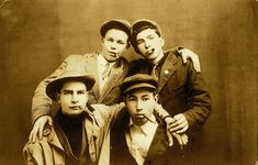 https://flic.kr/p/6oaYLG | Four young men, circa 1910 | Scanned real photo postcard