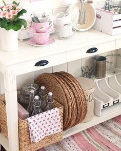 A simple sofa table can be used for storage in a kitchen.