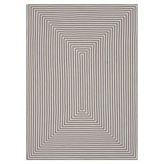 Add a chic focal point to your foyer, den, or master suite with this lovely hand-braided rug, featuring an eye-catching concentric stripe motif.