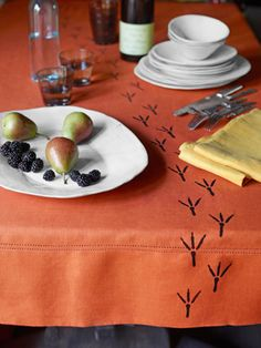 Stop dinner guests dead in their tracks with a custom-stamped tablecloth.