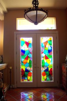 Custom stained glass windows for front entry. Created by Designer Art Glass in Daytona Beach Fl.