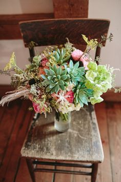 succulent-filled bouquet // photo by Kate Miller Photography // http://ruffledblog.com/whimsical-illinois-barn-wedding
