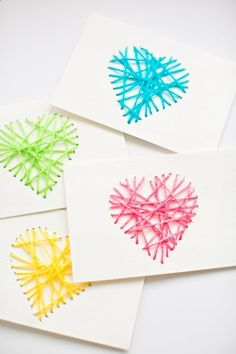 Make String Heart Yarn Cards. These make pretty handmade Valentine cards and are a great threading activity for kids!