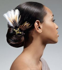 Ponytail hairstyle featuring feather accents.