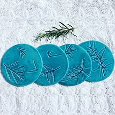 Ceramic turquoise coasters imprined with rosemary. X4 £25.00