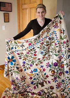 From Laundry Basket Quilts Blog.  I'm intrigued that she provides die-cut shapes backed with fusible web, too.