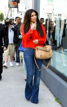 - Kim Kardashian in red & flaired jeans