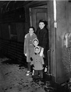 Judy and her three children -- Liza Minnelli (12), Lorna Luft (5) and Joseph Luft (3) -- arrive on the 20th Century train line from California to New York.