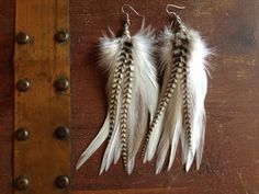 I just love black and white...  Thought these were gorgeous!  White and Grizzly Feather earrings  soft real by PrettyVagrant, $19.00
