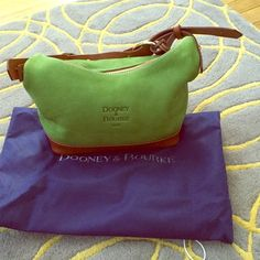 Dooney & Bourke Suede Kelly Green Bag Vintage green suede Dooney & Bourke used once like new condition comes with registration card and dust bag. Cleaning out my closet and anything not used must go to a new loving home. Pet and smoke free home  No swaps or trades but willing to negotiate via the offer feature. Fast shipper ships within 24 hours no reasonable offer refused let's talk bags Dooney & Bourke Bags Shoulder Bags