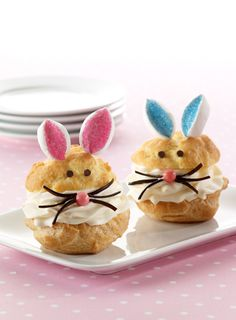 "Cut large marshmallows into pieces and dip in decorator sugar to make bunny ""ears"" for these cute cream puffs."
