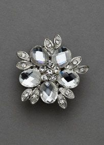 Dress up any outfit or shoe with this gorgeous crystal clip!  Beautiful floral clip features crystal stone detailing.  Available in Silver.  Imported.