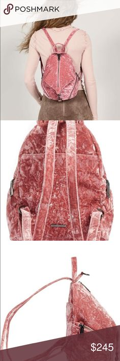 NWT (Rebecca Minkoff) medium velvet Julian Pink crushed velvet adds a luxe, trend-forward look to a fan-favorite backpack featuring lots of pockets to keep you organized on the go. Zip closure Top handle; adjustable backpack straps Two exterior zip pockets; exterior slip pocket Clip can be attached to top of bag for added security Interior zip and smartphone pockets Signature print lining Textile Imported Handbags Rebecca Minkoff Bags Backpacks