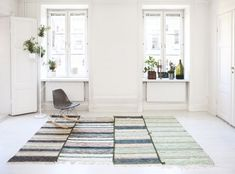 Rug runners. Looks great when you put a few of them together like that when the rest of room is minimalistic.