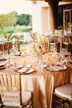 Gold or champagne satin - maybe no overlay if the chair sleeves & ruffles will be so extravagant. =)