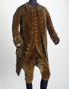 Brown velvet suit, coat, waistcoat and breeches, English, 1758-61. Worn by actor David Garrick to have his portrait painted. The portrait now hangs in the Ashmolean Museum in Oxford. Garrick became famous for acting in a natural and lively way. This made a refreshing change for audiences who were used to performers with a stylised delivery and gestures, and eventually became an Actor-Manager of the Theatre in Drury Lane.
