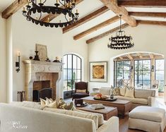 """Smitten with a Spanish Colonial-style house in San Francisco, interior designer Maria Haidamus created a personalized home of her own. """"The moment I saw the house, it transported me to a different time and place,"""" says Haidamus. Mediterranean Living Rooms, French Country Living Room, Rustic French, Wood Beams, Great Rooms, Living Room Decor, Dining Room, Family Room, Interior Design"""