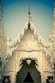 Wat Rong Khun (Thai: วัดร่องขุ่น)  ::   White Temple - this is  beautiful beautiful place. We were awe when we visited there. But, all of Thailand is pretty memorable.