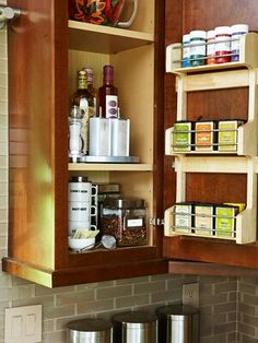 Spice Things Up  Make a cabinet beside the range more functional for storing your favorite flavoring ingredients. Add a rack inside the door for spices and rest a turntable on one shelf so you can spin bottles of oils and vinegars into view. Decant other foods and spices into clear or labeled containers for quick inventory and easy stacking.