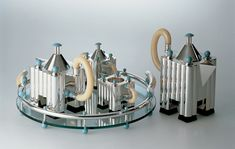 """Limited edition silver tea and coffee set by Michael Graves for Alessi. Michael Graves, understanding that they were extremely interested in trying real industrial design, meaning products made for the masses. Michael Graves, Silver Teapot, Art Deco, Coffee Service, Memphis Design, Shops, Coffee Set, Chocolate Pots, Kettle"