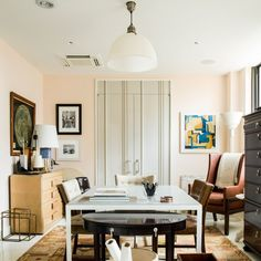 Benjamin Moore's Tissue Pink. Andrea Magno suggests doing the ceiling of a dark-walled dining room in this colour...