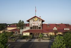 When people visit Bass Pro Shops, it's usually for more than just shopping. With an aquarium, shooting gallery and 3-D archery range along with a bar and restaurant, the retailer chose to use a metal roof to protect the building long into the future. The roof stands out in Colonial Red coatings to make Bass Pro Shops a standout destination.  Coatings: Colonial Red Metal Panel Supplier: Petersen Aluminum Photo Credit: hortonphotoinc.com #metalroof #metalpanels #wecoveredthat #metalroofing Archery Range, Metal Panels, Metal Roof, Photo Credit, Colonial, Bass, 3 D, Aquarium, Shops