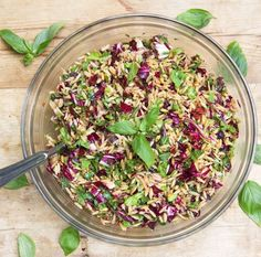 Out of this world pasta salad: orzo pasta with chopped radicchio, basil, parmesan, sun-dried tomatoes, kalamata olives, toasted pine nuts, balsamic vinegar, garlic, olive oil.