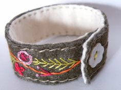 Embroidery Bracelets Ideas Embroidered Bracelet using felt, hand embroidery and pearl button fastening Embroidery Shop, Learn Embroidery, Beaded Embroidery, Hand Embroidery, Floral Embroidery, Embroidery Designs, Embroidery Floss Bracelets, Fabric Bracelets, Wire Bracelets