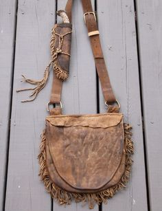 Primitive Mountain Man possibles bag with Antler Knife and sheath attached to strap. For more primitive knives, leather bags and other mountain man/ fur trade items go to: http://www.etsy.com/shop/misstudy Made in rural N.C. at Out of the Ashes Forge by Tudy (leather and bead work) and Bud Smith (blacksmith/ knife maker)