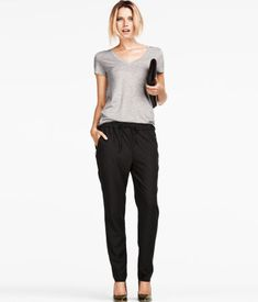 Loose-fitting pants with tapered legs and elasticized drawstring waistband.