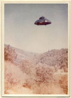 """Henry Rowland was doing landscape work for a client in California in the 1970s. The client asked Henry, """"Do you want to see a picture my brother took last week?"""" He returned with this picture of a UFO and explained, """"My brother went to the mountains last week, and while on the trip he saw this craft disappear behind a hill. He ran to his car to get his camera, and in the nick of time held it up the split second when the thing reappeared again from behind the hill and shot off into the sky."""""""