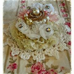 Sprinkles Cupcake Doily Flower  Vintage Doilies, Lace, Pearls, Bow and a few Vintage Rhinestones  Designed by Doreen Rook