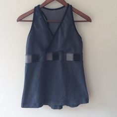 NEW LISTINGLululemon Gray Tank Stylish, gently used gray tank top with patchwork band, mesh racer back and built-in shelf bra with holes for pads. This tank is in good used condition with no stains or rips and just a little piling. lululemon athletica Tops Tank Tops