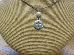 Sterling Silver Cut-Out  Cross...topped with pearl & strung on our tiny(but durable) braided  cord for all the time wear.
