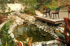 Waterfall, Pond, and Raised Patio.   Aaron builds this