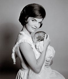 The American First Lady Jacqueline Kennedy photographed by Richard Avedon with her son John Kennedy Jr., at the White House for a editorial made for Harper's Bazaar, in February 1961.