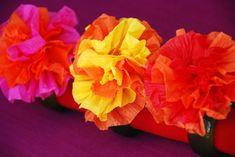 Mexican crepe paper flowers fpr Cinco de Mayo napkin rings.  DIY
