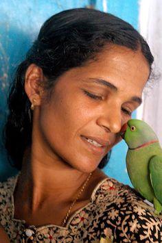 Woman with a Bird, Kerala, India by Jennifer Esperanza, via Flickr