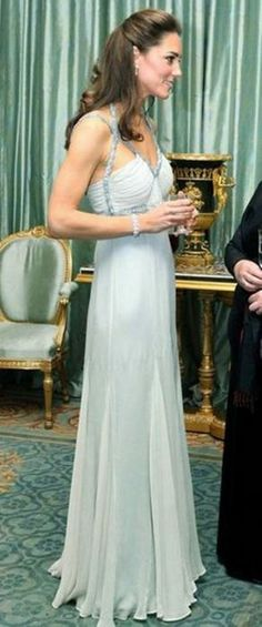 The Duchess hosts her first solo engagement for Prince Charles in a vintage Amanda Wakeley gown. Stunning!