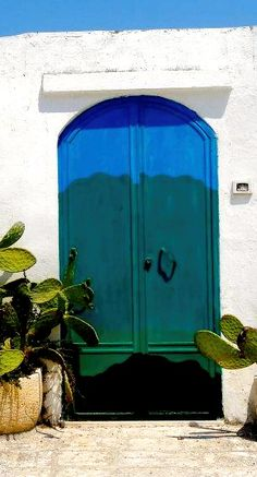 A colorful doorway in Ostuni, Italy. Ostuni is a beautiful whitewashed city in Apulia that, along with Alberobello should be added to everybody's Italy travel plans #Italy #Italia #Ostuni #Alberbello #Travel